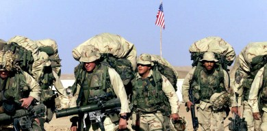 Merkel urges greater civilian role for NATO