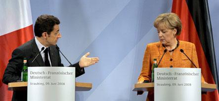 Merkel and Sarkozy resolve dispute over car emissions