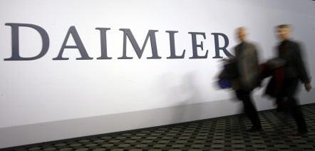 Daimler lowers profit forecast even as second quarter sales rise