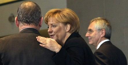 Opel executives go cap-in-hand to Merkel