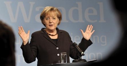 Merkel pledges aid to depressed west