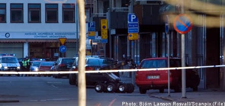 Sixteen charged for brazen postal heist