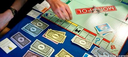 Woman exchanges Monopoly money for Danish kroner