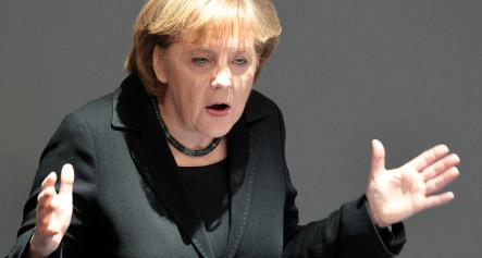 Merkel defends Berlin's crisis management
