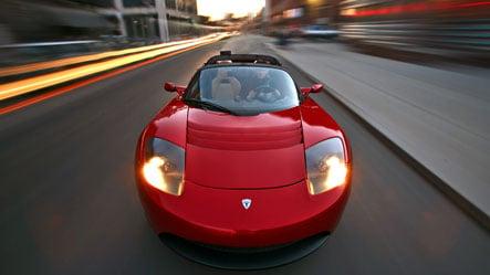Daimler buys into electric carmaker Tesla