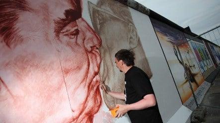 Berlin Wall art restoration in full swing ahead of anniversary