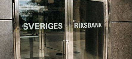 Riksbank halves interest rates