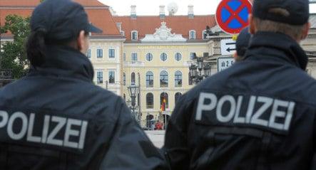 Merkel's guards revealed as ex-Stasi