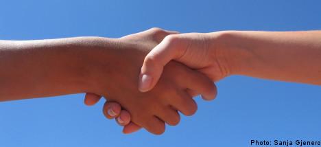 Swedish school bans handshakes amid swine flu fears