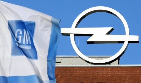 Merkel prods GM to decide Opel's fate