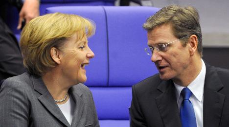 Merkel backs coalition between CDU and FDP