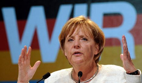 Merkel demands equal pay for women