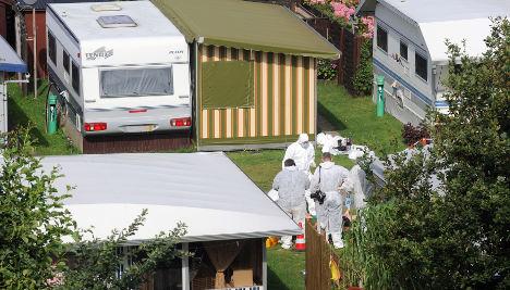 Suspect questioned in campsite double murder