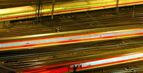 Drunk woman run over by train survives tucked between tracks
