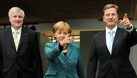 Merkel's new coalition hammers out final issues