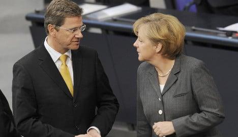 Merkel starts contentious coalition talks with FDP