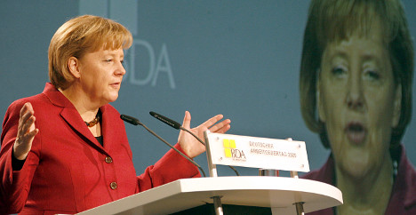 Merkel expects 'thank you' as GM repays loans