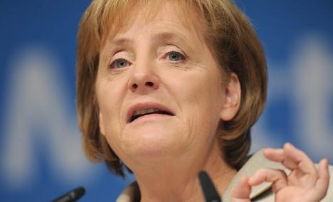 Merkel warns banks over tight lending habits