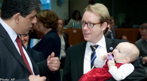 Swedish minister's infant daughter steals Brussels spotlight
