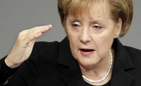 Merkel aims to turn tide with fiery speech