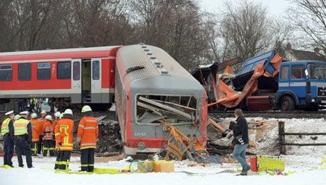 Twelve injured in train collision with truck