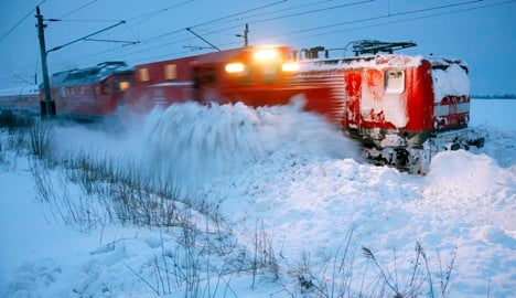 Train hits snow-clearing vehicle