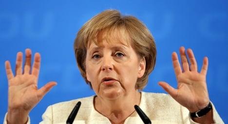 Merkel rejects weak leadership criticism
