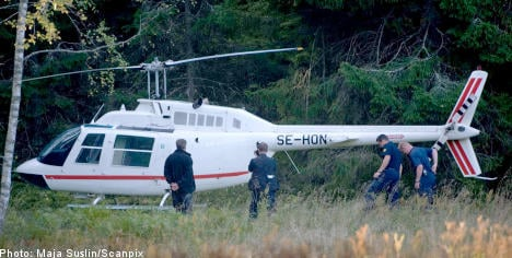 Helicopter suspect held on Caribbean island