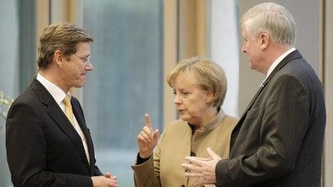 Merkel holds crisis talks as squabbles tarnish coalition