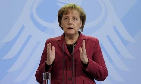 Merkel warns Iran of coming sanctions