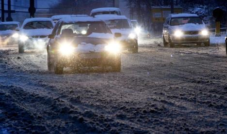 Snow and ice snarl roads and air traffic