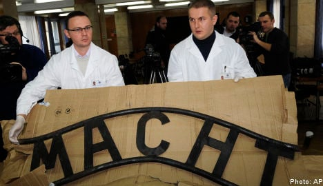 Three in Sweden sought for Auschwitz sign theft