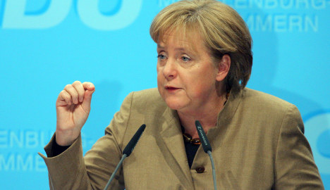Merkel chides banks for role in Greek crisis