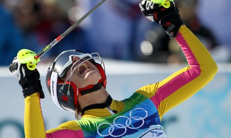 Riesch takes gold in super-combined