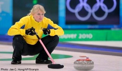 Sweden defends curling gold