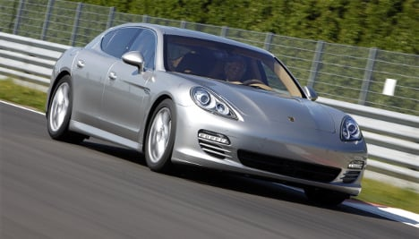 Porsche sheds debt but expects yearly loss