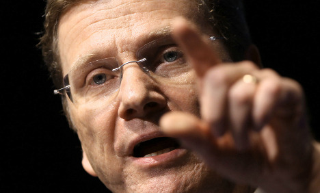 Westerwelle calls criticism of trips 'slander'
