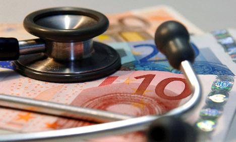 Rösler mulling extra per capita health insurance premium