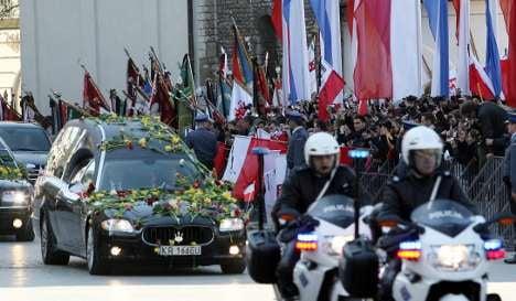 Merkel misses Kaczynski funeral but Westerwelle takes helicopter