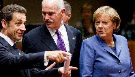 Sarkozy and Merkel push stricter eurozone rules