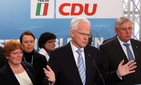 CDU defeat a 'double debacle,' press says