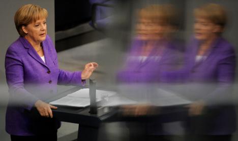 Merkel warns Europe's fate tied to euro