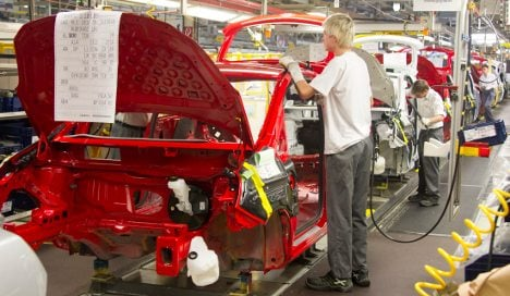 Opel agrees on restructuring plan with unions