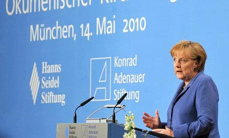 Merkel says major budget cuts on the horizon