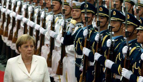 Merkel pushes China to open its markets