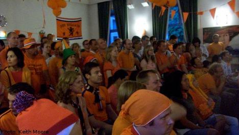 Stockholm goes orange as Dutch claim final spot