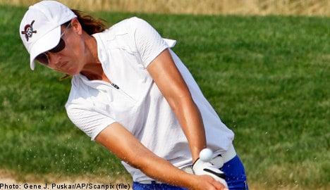 LPGA's Gustafson leads rain-delayed US Open