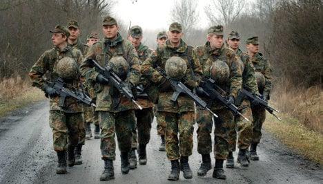 Westerwelle urges quick end to conscription