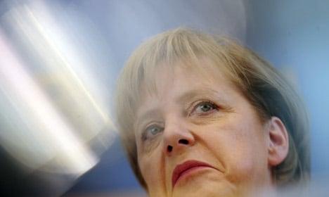 Economy revs up but Merkel still sputters