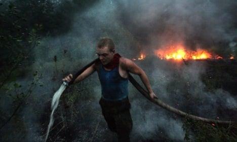 Merkel offers aid in fighting Russian fires